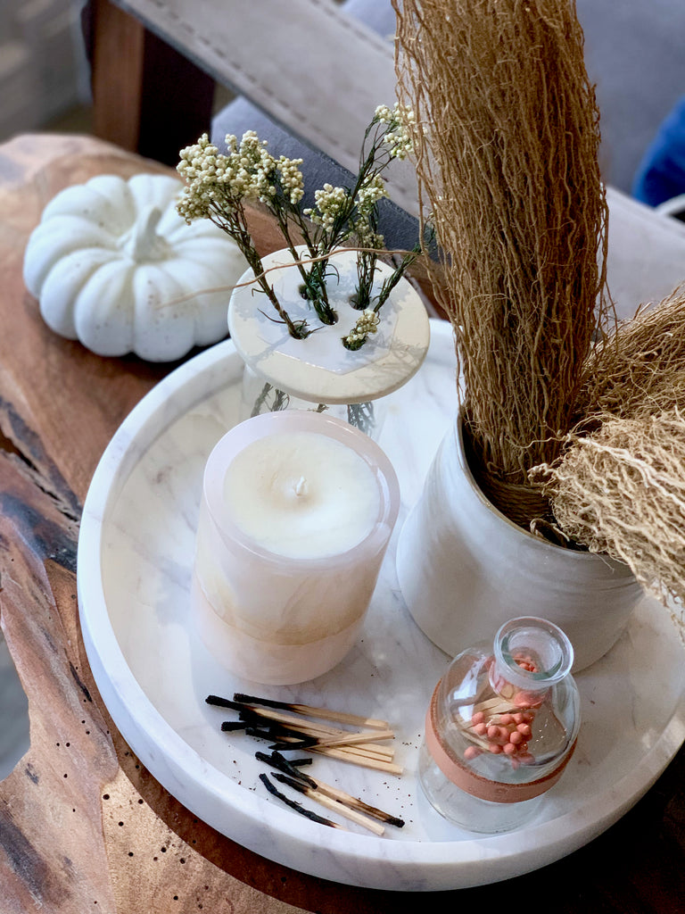 Is there anything more dreamy than a candle in Autumn? The one-of-a-kind Pink Onyx Candle and jar of matchsticks are beautifully accented with dried flowers and bundles.