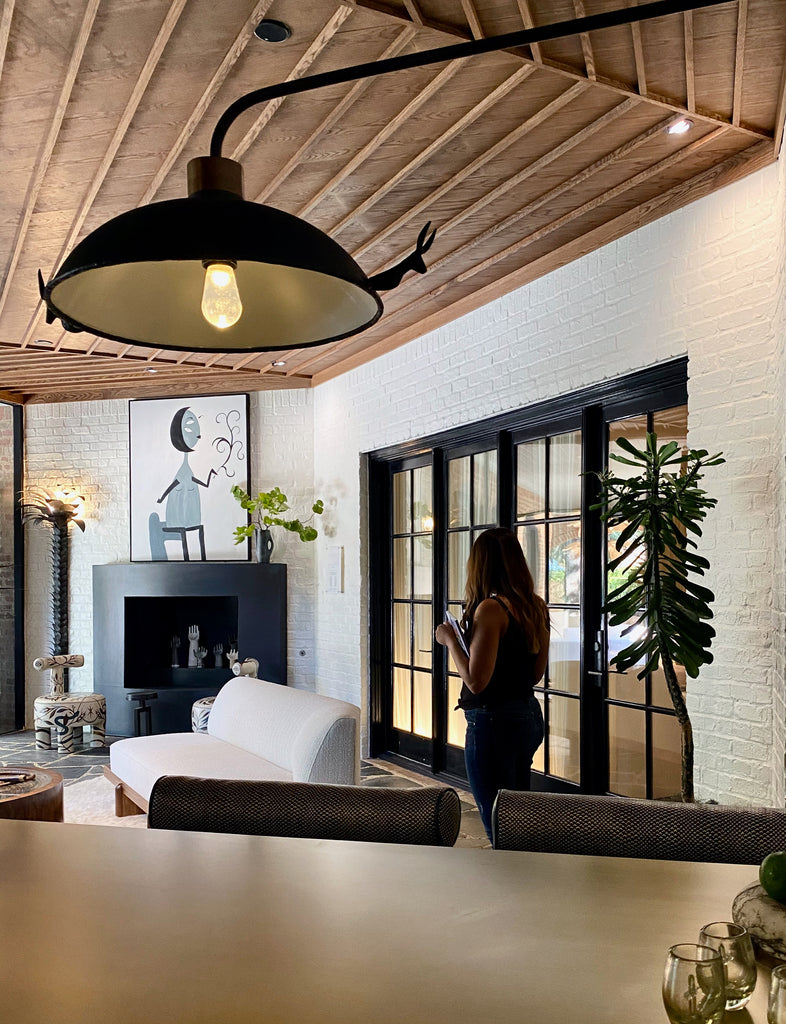 Sunroom Bar by Tracy Hardenburg Designs  Okay -- I'm totally making up names for these spaces!  Loved the high top table with the built in ice bucket...white brick walls...incredible warm wooden ceiling detail...black fireplace with art...
