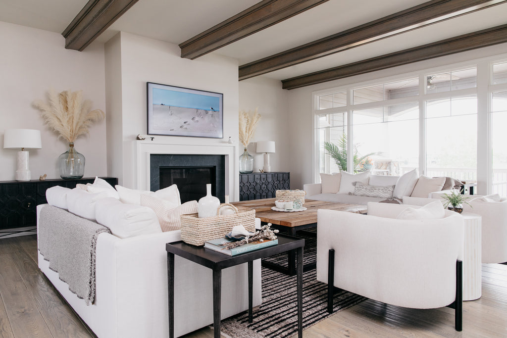 Verellen excelled with the custom order Thibaut sofas in the precise white upholstery needs of the client. The black cabinets bring a modern look to this beach house and interesting contrast.