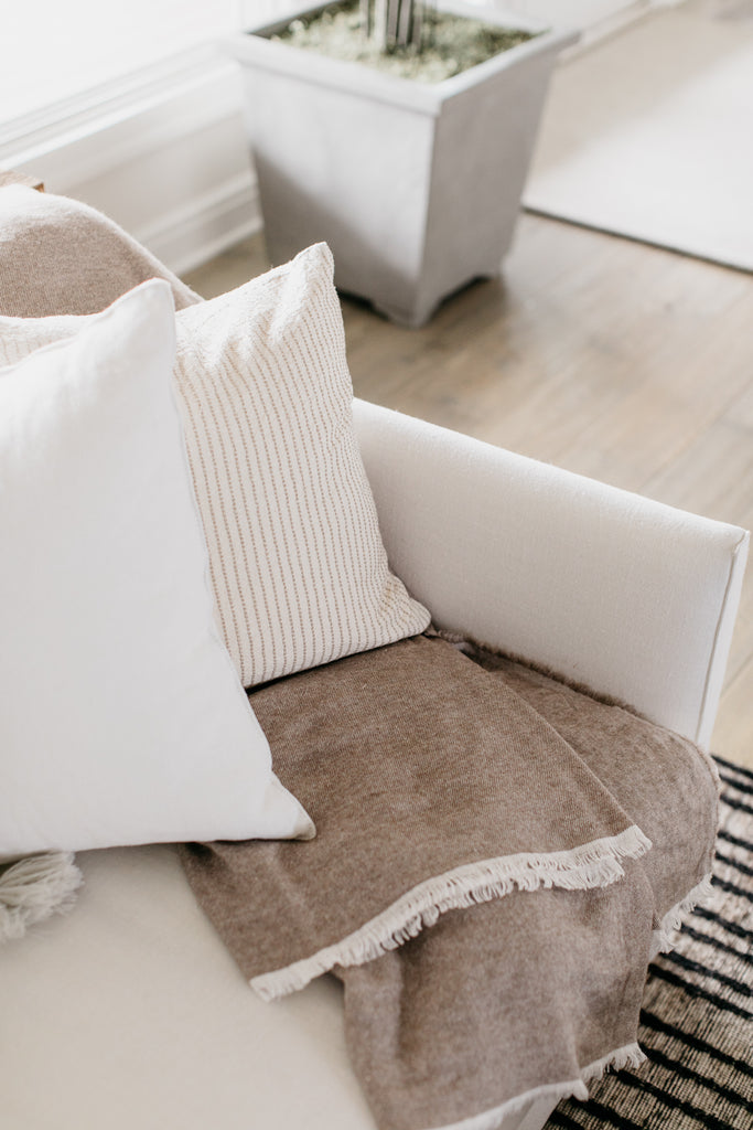 The Cameron Alpaca Throw from Uniquity in Belgium goes gorgeously well with any Verellen sofa, especially this Thibaut sofa in white denim and these soft pillows.