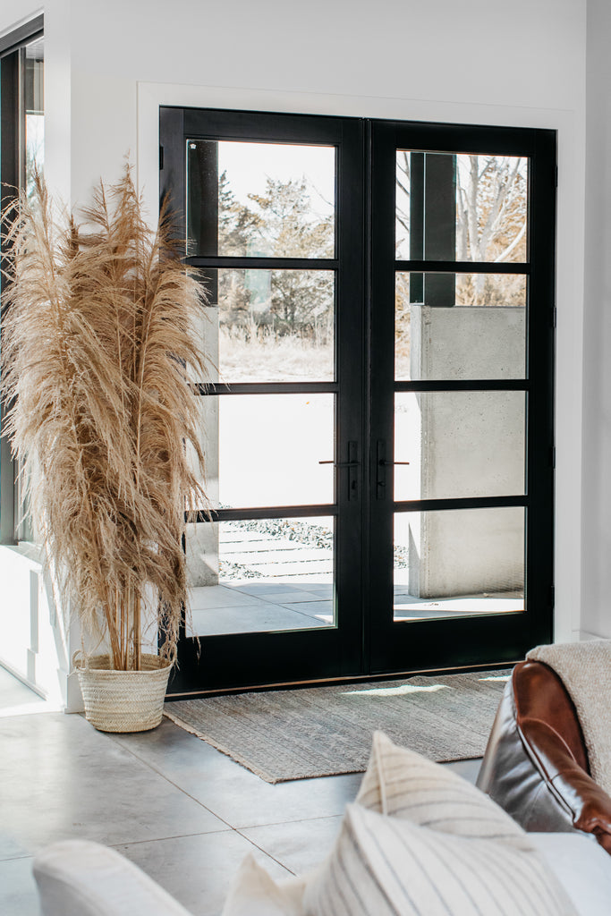 Peaceful entryway with a hand-knotted, elevated rug with a mix of beautiful blues and greys.