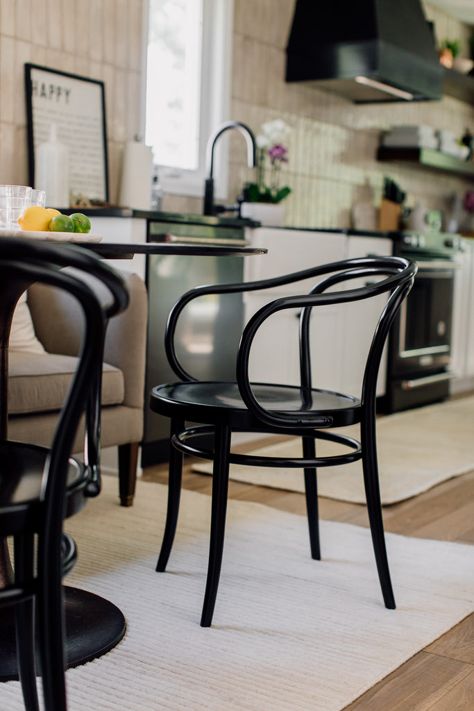The swoony lines on these black cane chairs are soft and modern we love seeing every time we go into the kitchen.