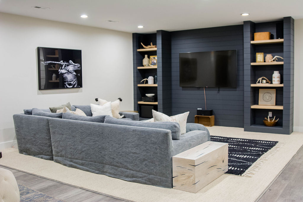 The Loft sectional sofa from Cisco Brothers even looks gorgeous from the back with the slipcovered tailored to sit directly on top of any surface. We love seeing the Ario pillows and the Fret Art to add rock'n'roll style to any room.