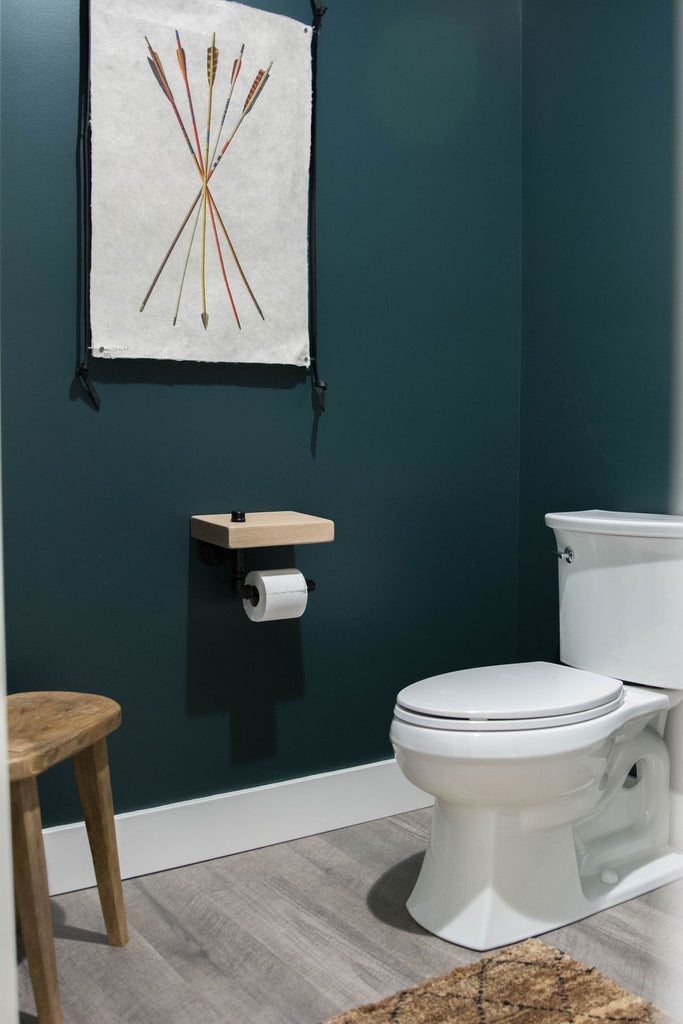 This bathroom also features arrow print art from Barloga to add different colors and beautiful hand-made paper from Nepal.