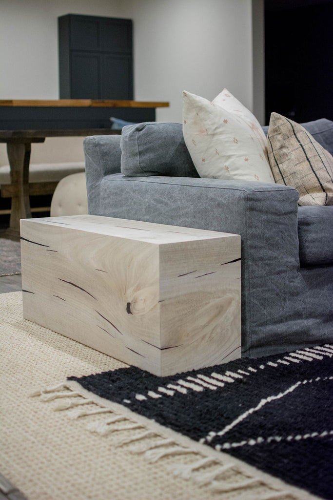 To keep with the goal of natural fibers and textures, this Yukas side table is a wonderful way to add natural elements as a side table along the sofa.