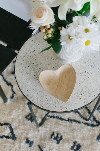 Carved wooden heart bowl and fresh flowers.