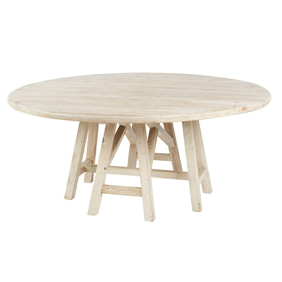 "Combining the naturally bare look of white pine with a complex geometric base, this Round Trestle White Pine Table makes for a creative and sophisticated piece of furniture. Crafted with elegance, this gorgeous dining table is made of natural pine that has been cleverly softened by its white wash finish.  Size: 72""d x 30""h  Material: White Pine"
