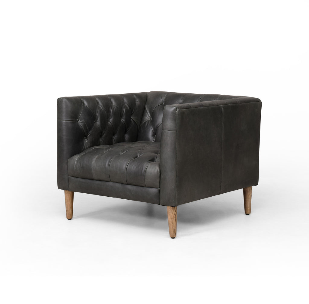 "The Williams Natural Washed Ebony Leather Chair is tufted and well-tailored. Squared shelter arms and a low profile deliver a dose of mid-century flair to top-grain leather seating in a natural washed ebony.  Size: 33""w x 35""d x 28""h Seat Depth: 24.5"" Seat Height: 17"" Arm Height from Seat: 11.75"""