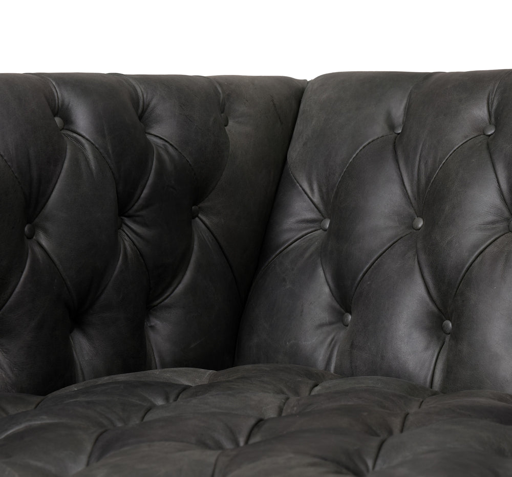 "The Williams 75"" Natural Washed Ebony Leather Sofa is tufted and well-tailored. Squared shelter arms and a low profile deliver a dose of mid-century flair to top-grain leather seating in a natural washed ebony.  Ready for shipment Early October 2020.  Overall Dimensions: 75""w x 35""d x 28""h Seat Depth: 24.5"" Seat Height: 17"" Arm Height from Seat: 11.75""  Materials: Top Grain Leather, Solid Oak"