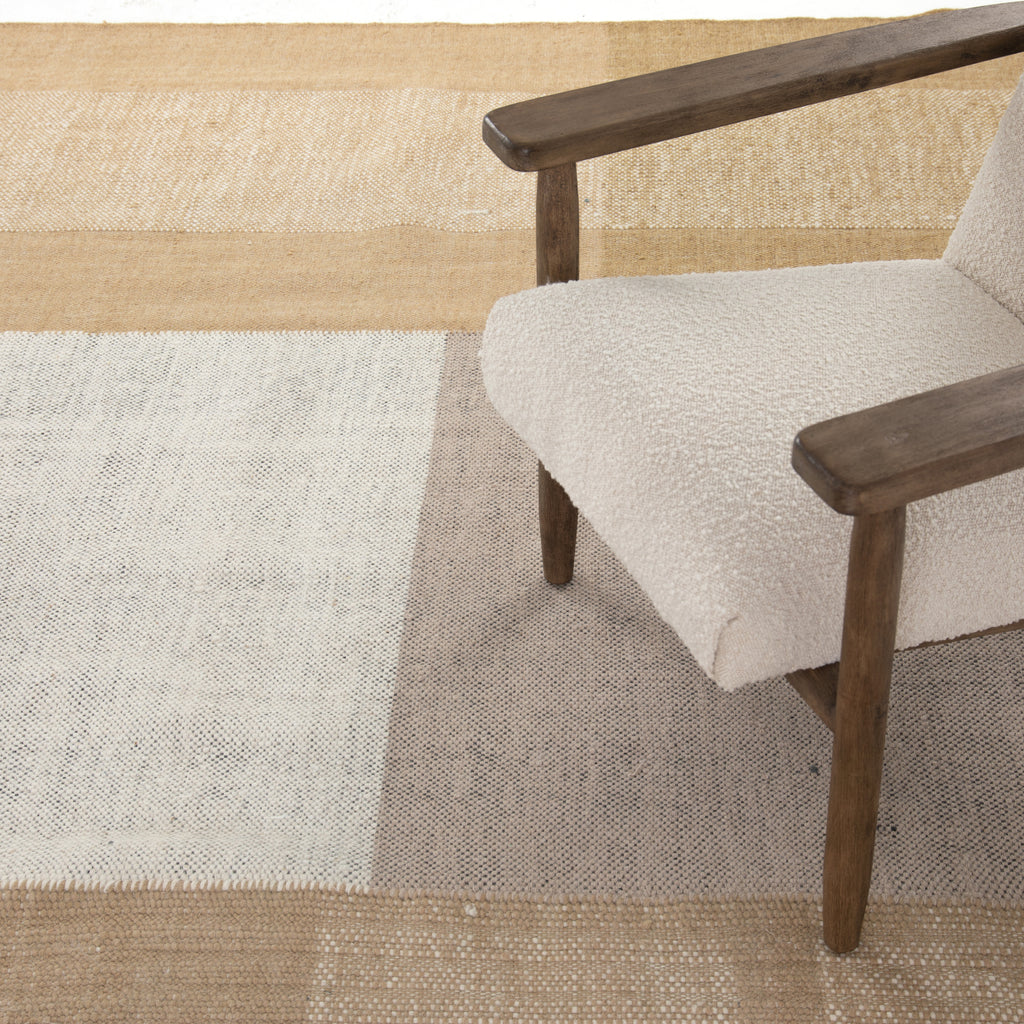 "The Bran Saffron, Khaki, & Cream Rug is aninvitation to the block party. A tonal area rug of 100% wool features a multi-color block pattern of beautiful neutrals, plus fringe for added flair.  Size for 8'x10': 96""w x .5""d x 120""h Size for 9'x12': 108""w x 0.5""d x 144""h"