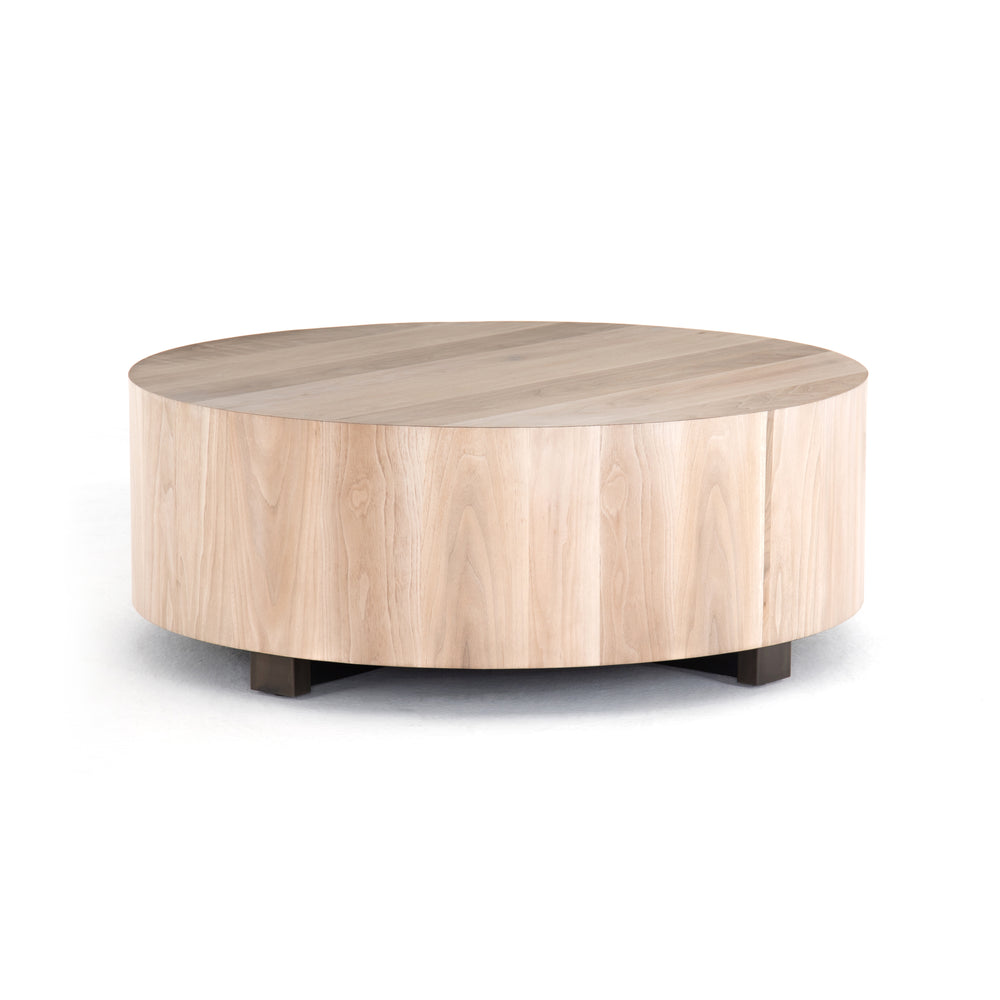 "Stunning forces of nature are captured in the Hudson Coffee Table. We love how the palted primavera wood is hand-shaped into a cylindrical silhouette.   Overall Dimensions: 40""w x 40""d x 15""h  Materials: Yukas, Iron Materials: Iron, Primavera Materials: Iron, Thick Walnut Veneer"