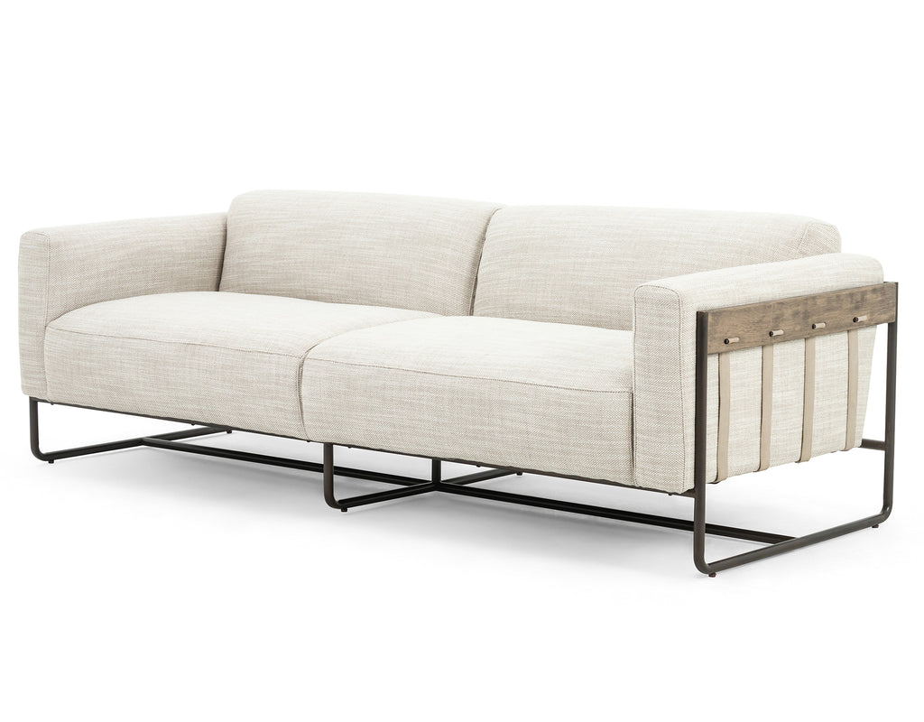 "Neutral gone novel with this Ella Gable Taupe 91"" Sofa. Taupe-colored upholstered seating is suspended by top-grain leather straps with handcrafted fastens, for an airy look. Solid rubberwood paneling wraps the frame's entirety, while a black iron base lends lightness and contrast.  Available early October 2020!  Overall Dimensions: 91.00""w x 37.50""d x 30.25""h Materials: 82% Pl 16% Pc 2%Wo, Iron, 100% Top Grain Leath, Solid Parawood"