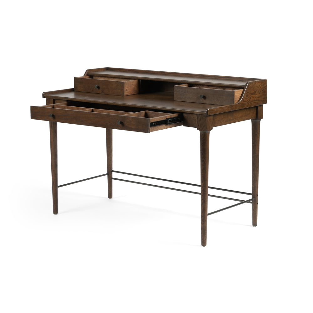"Dark-toasted oak's rich brown finish speaks to mid-century inspiration, while plenty of storage meets the needs of a modern office with this Moreau Dark Toasted Oak Writing Desk.   Overall Dimensions: 48""w x 23.5""d x 34.75""h"