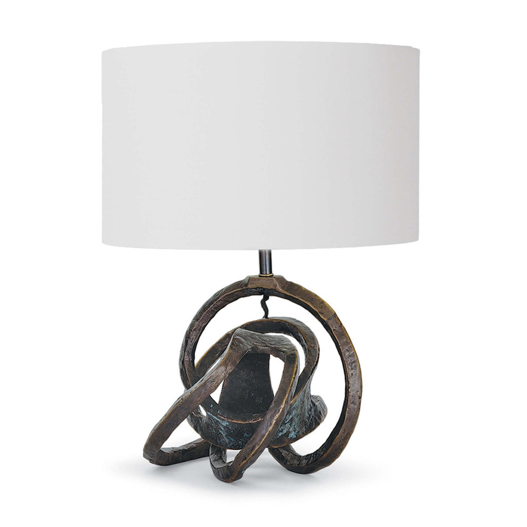 Stunning from any angle and imperfect by intent, the Knot Table Lamp is defined by its sculpted iron body. The bronze finish and natural linen drum shade completes the look of this artistic lamp. The chic look makes it a versatile option for the living or bedroom, or in pairs atop side tables flanked on each side of a sofa.