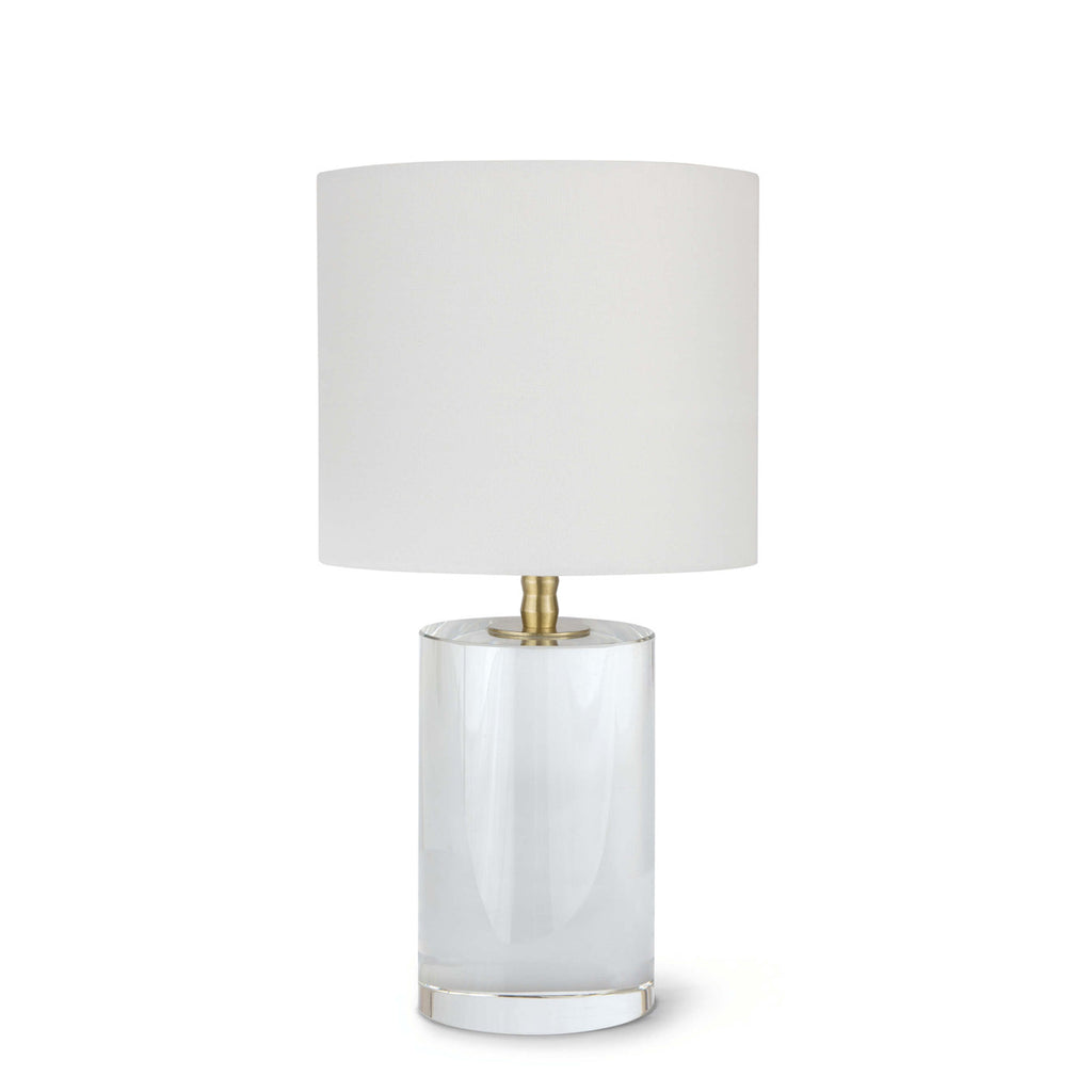 Stunning and elegant, the Juliet Table Lamp is crafted of optical crystal, fitted with natural brass hardware and topped with a natural linen drum shade. This clear and sculptural lamp lends itself to a variety of settings, making it a versatile option for the living or bedroom, or in pairs atop side tables flanked on each side of a sofa.