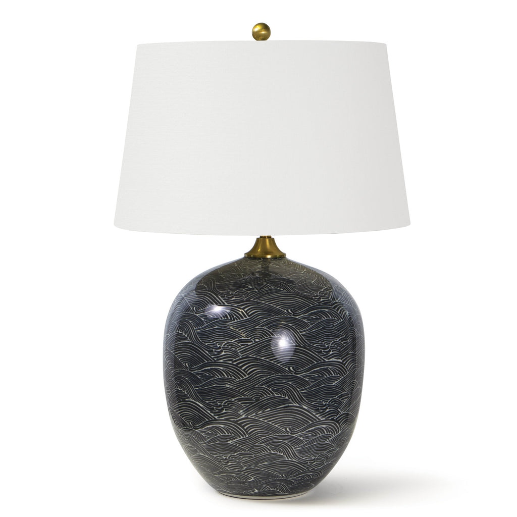"This Harbor Ceramic Table Lamp by Regina Andrew features a specialized glazing technique that highlights the gorgeous pattern in shades of black or blue. The natural linen shade brings a warm, sophisticated look to any living room, bedroom, or other area needing.  Overall Dimension: 18""w x 18""d x 29""h"