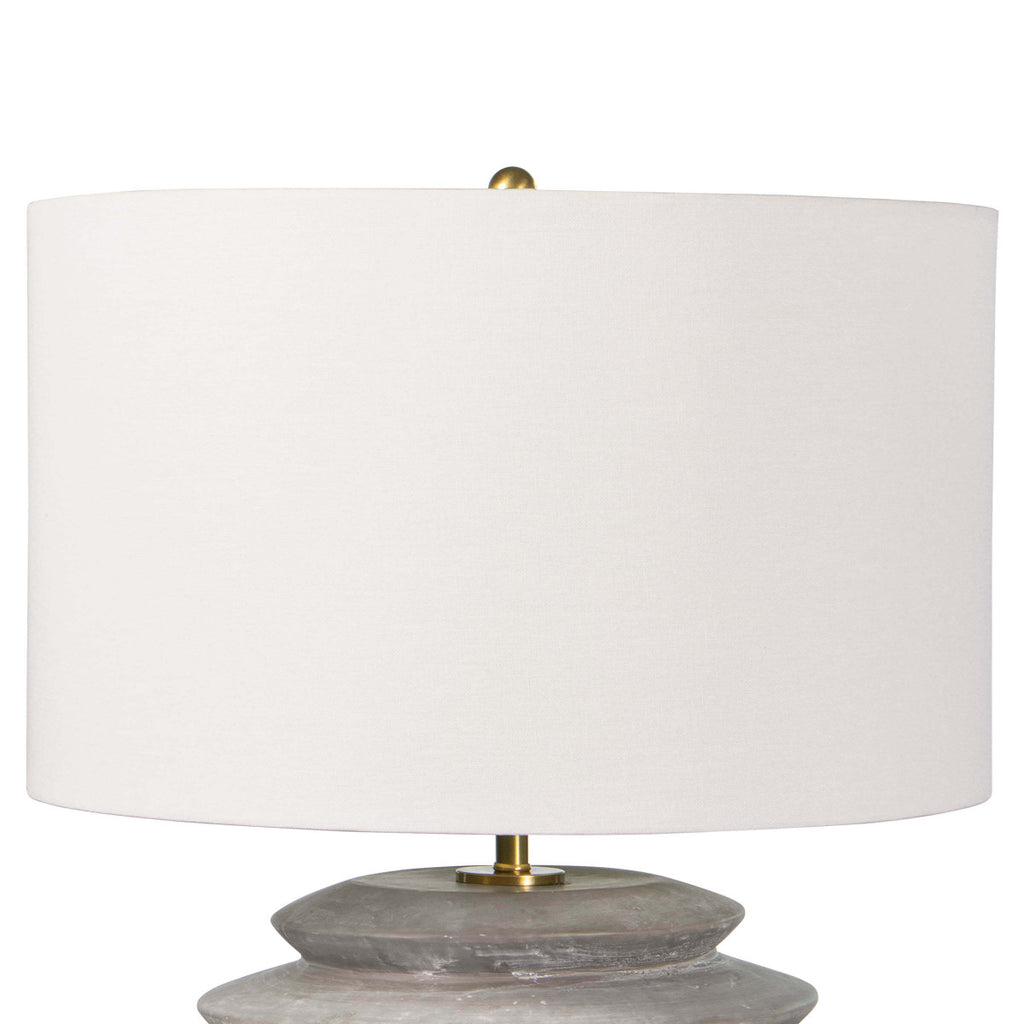 "This Canyon Ceramic Table Lamp has an earthy, yet bold feel with its natural linen shade and grey ceramic body. This is a statement in any bedroom or living room.   Size: 18""w x 18""d x 24.5""h Material: Ceramic"
