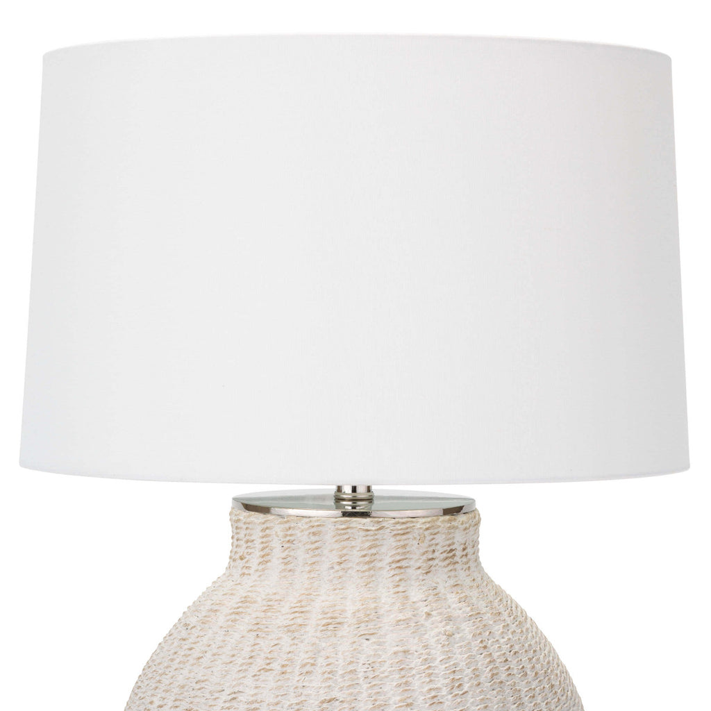 "The Hobi Table Lamp has a gorgeous white-washed, natural woven pattern that catches our eye. The casual elegance in this lamp completes the look for any living room or bedroom.   Size: 18""w x 18""d x 26.5""h Material: Natural Material"