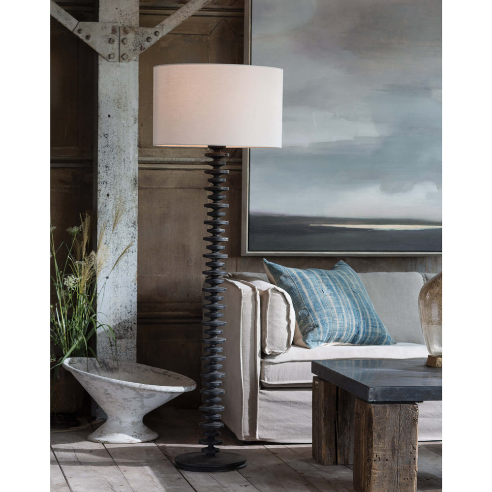 Textured bands ripple down the graduated column of our sculptural Fishbone floor lamp. Corrugated birch wood is handcrafted by artisans and balanced with a natural linen shade. This elegant profile makes a simple yet stunning statement to any living room, bedroom or den.