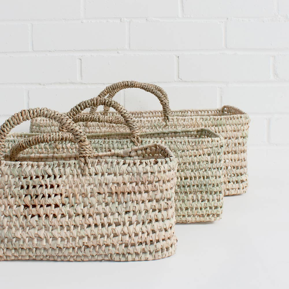 The Small Storage Basket is handwoven in Moroccan in a robust open weave using sustainable palm leaf and can be used as a fruit or bread basket or an ideal home storage solution.