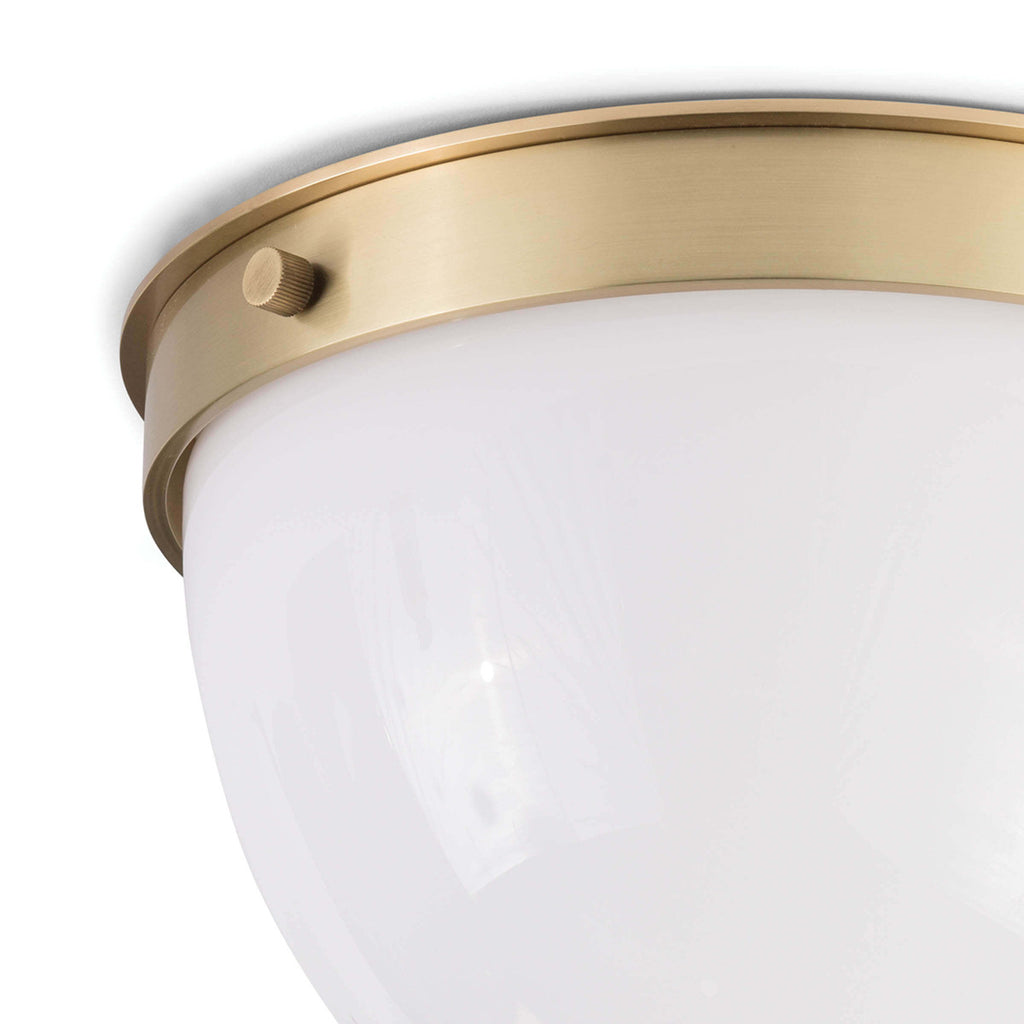 "We love the warm and glowing look the white opal glass gives when illuminated in this Bay Harbor Natural Brass Flush Mount. This would look stunning in areas with lower ceilings or in hallways.   Size: 11""w x 11""d x 7.5""h Material: Steel"