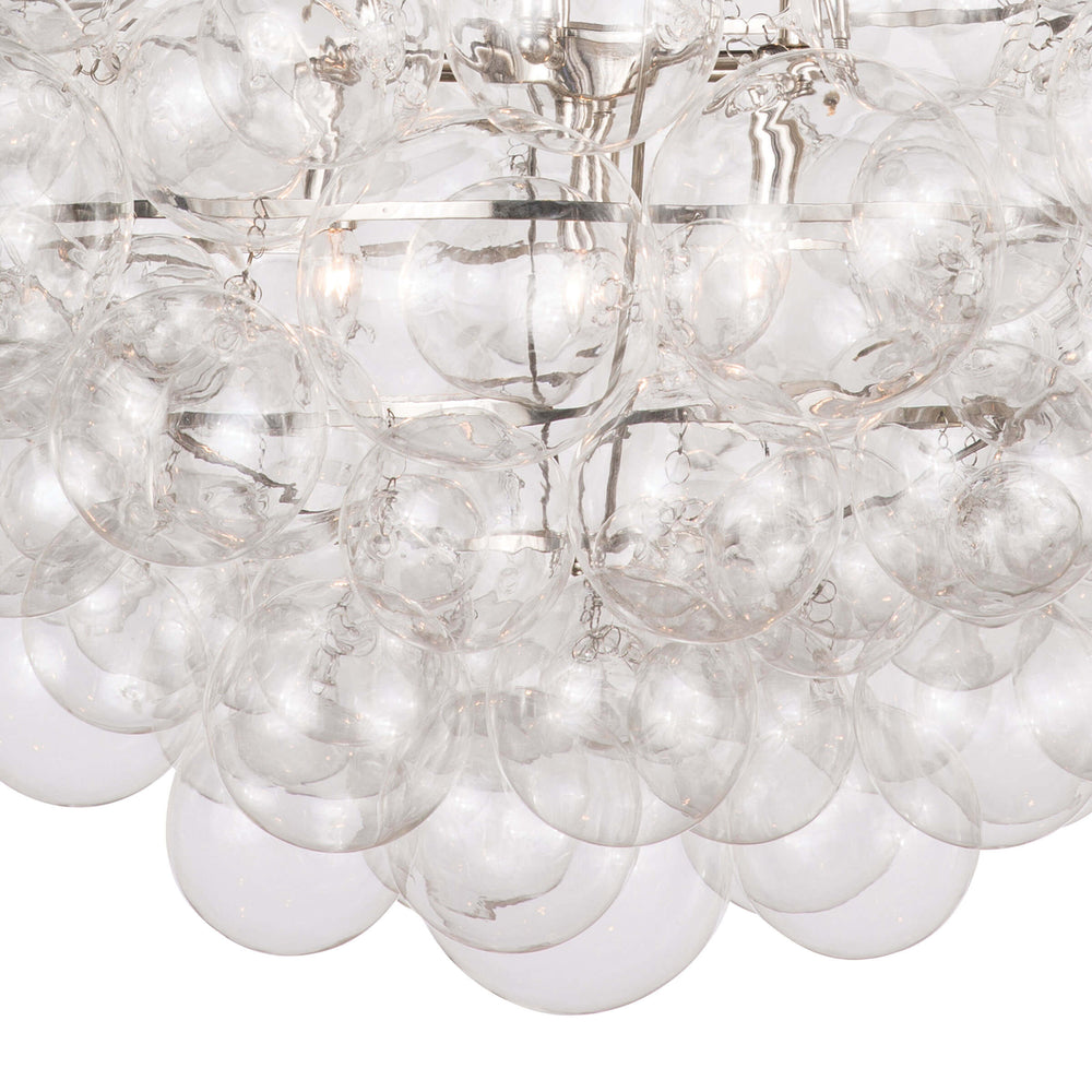 Nimbus chandelier lives up to its name, featuring hundreds of glass balls in varying sizes that create a cloud-like orb, suspended by a polished nickel frame and chain. Make a statement in your living room or above a dining table with this airy fixture.