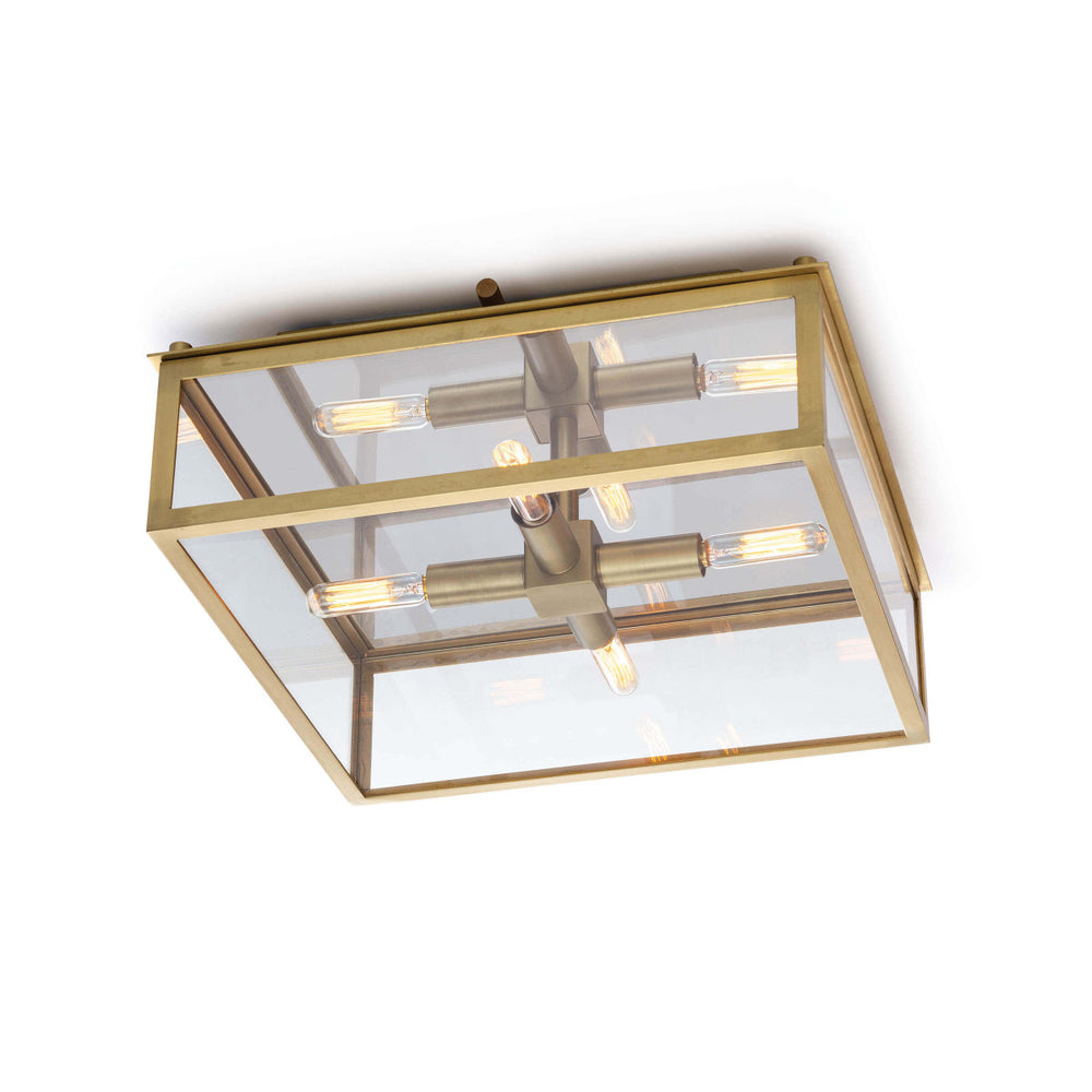 "The modern silhouette and classic details of the Ritz Natural Brass Flush Mount make a timeless design. We love the warm glow and elegance this can bring to any bathroom, entryway, or hallway.   Size: 14.5""w x 14.5""d x 5.75""h Material: Glass"