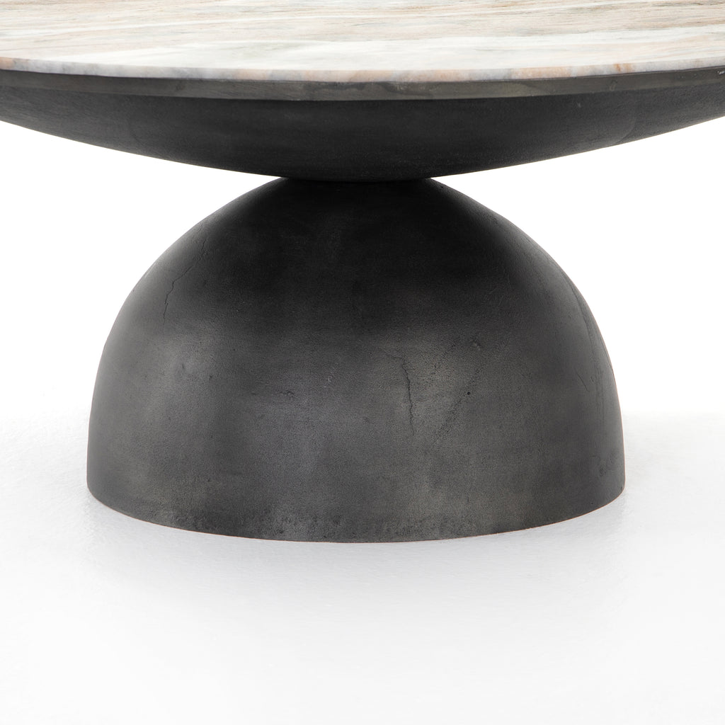 "We love the sculptural play on shape the Corbett Creamy Taupe Coffee Table has. Hammered grey-finished aluminum base supports a grand, rounded tabletop of creamy taupe marble with beautiful natural veining.  Ready to ship within 6-8 weeks. Some things are worth the wait!   Overall Dimensions: 35""w x 35""d x 15""h Materials: Aluminum, Solid Marble"