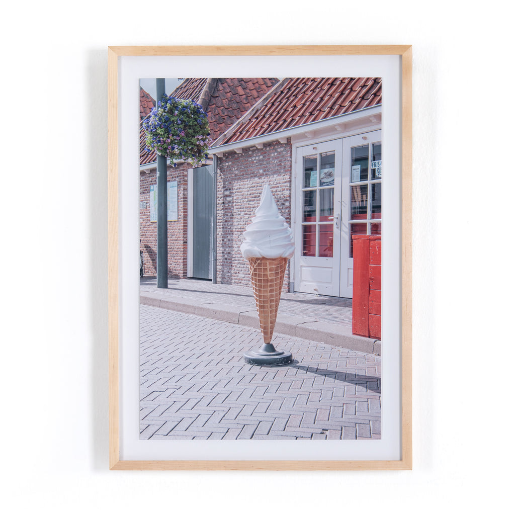 "The Ice Cream Cone by Markus Bex is inspired by the landscapes and automobiles of the American Southwest. German photographer Marcus Bex's sweet, retro-spun capture is printed on top-quality photo paper with natural maple framing, for a museum-quality look. Handmade in Austin, Texas. Please allow 3-4 weeks for production and shipment.  Size: 25""w x 2.5""d x 35""h"
