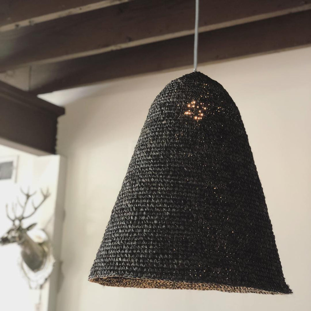 This hand-crafted pendant is made in Bali with natural black dyes to create a moody pendant perfect in any room.
