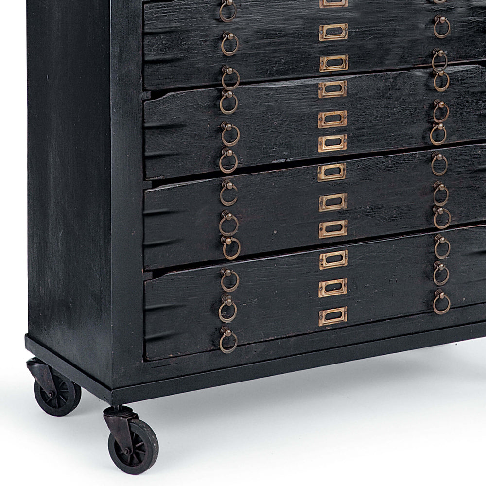 Crafted in vintage black mango wood and with brass hardware the Printmakers Cabinet has been reconfigured to accommodate more space while retaining its classic form.