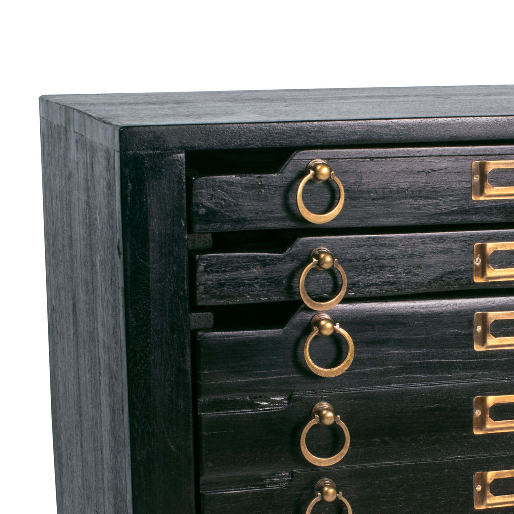 Crafted in vintage black mango wood and with brass hardware the Printmakers Nightstand has been reconfigured to accommodate more space while retaining its classic form.
