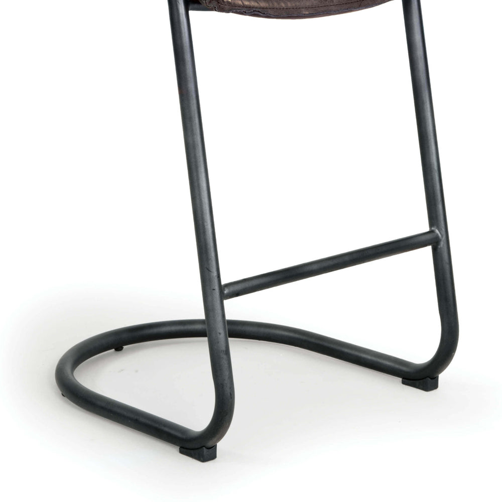 This gorgeous modernist bar stool pairs comfort and style. The low, contoured back and seat cradle the body for maximum comfort. Additional details like the reverse-seamed welting and vintage leather create new standards for a brave, relaxed style.