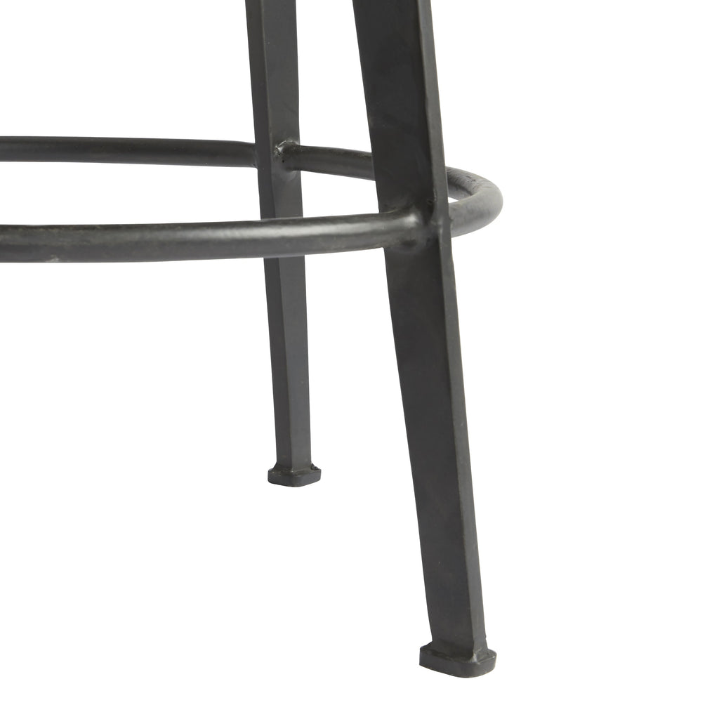 "The Benji's simple silhouette serves up some serious style with its sleek and slender four-legged, natural iron base and smooth, round wood seat. A brown smoke wash finish softens the natural grain of the wood, lending an industrial appeal to this iron stool. It also swivels—adding a fun element to its primary, and generally stationary, function.  Size: 25""h x 16""d x 16""w"