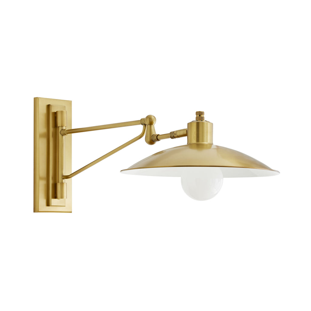 "Crafted entirely of steel and finished in antique brass, the unique mount and arm of this dynamic wall Nox Sconce deliver a distinct appeal to its existing vintage charm. It is mounted on an 180º swivel arm, and the shade has slight vertical maneuverability. Shown with a 5-inch frosted globe bulb. Damp-rated, although limited covered outdoor conditions may affect finish.  Size: 7-31""w x 14-21""h"