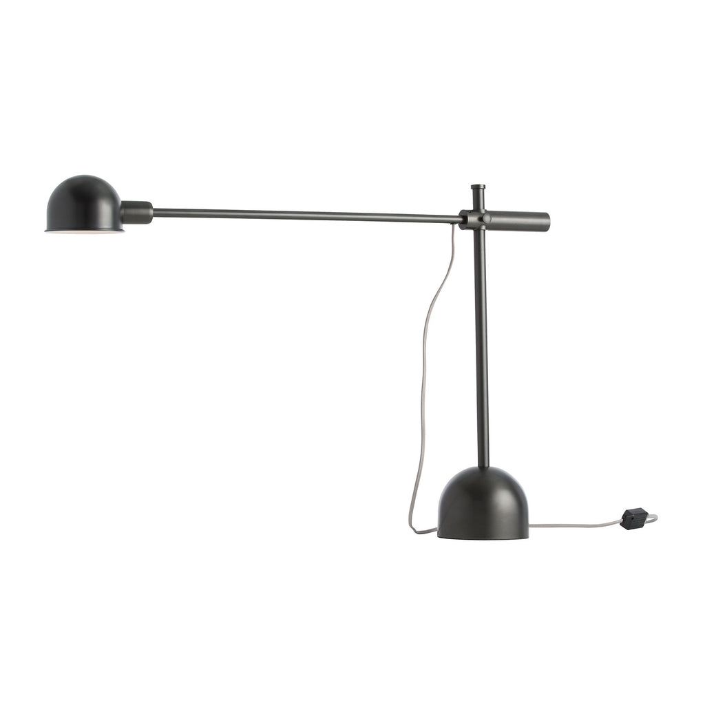 The lamp features oversized proportions and industrial details. The weighted base supports the adjustable height arm and swivel canopy.