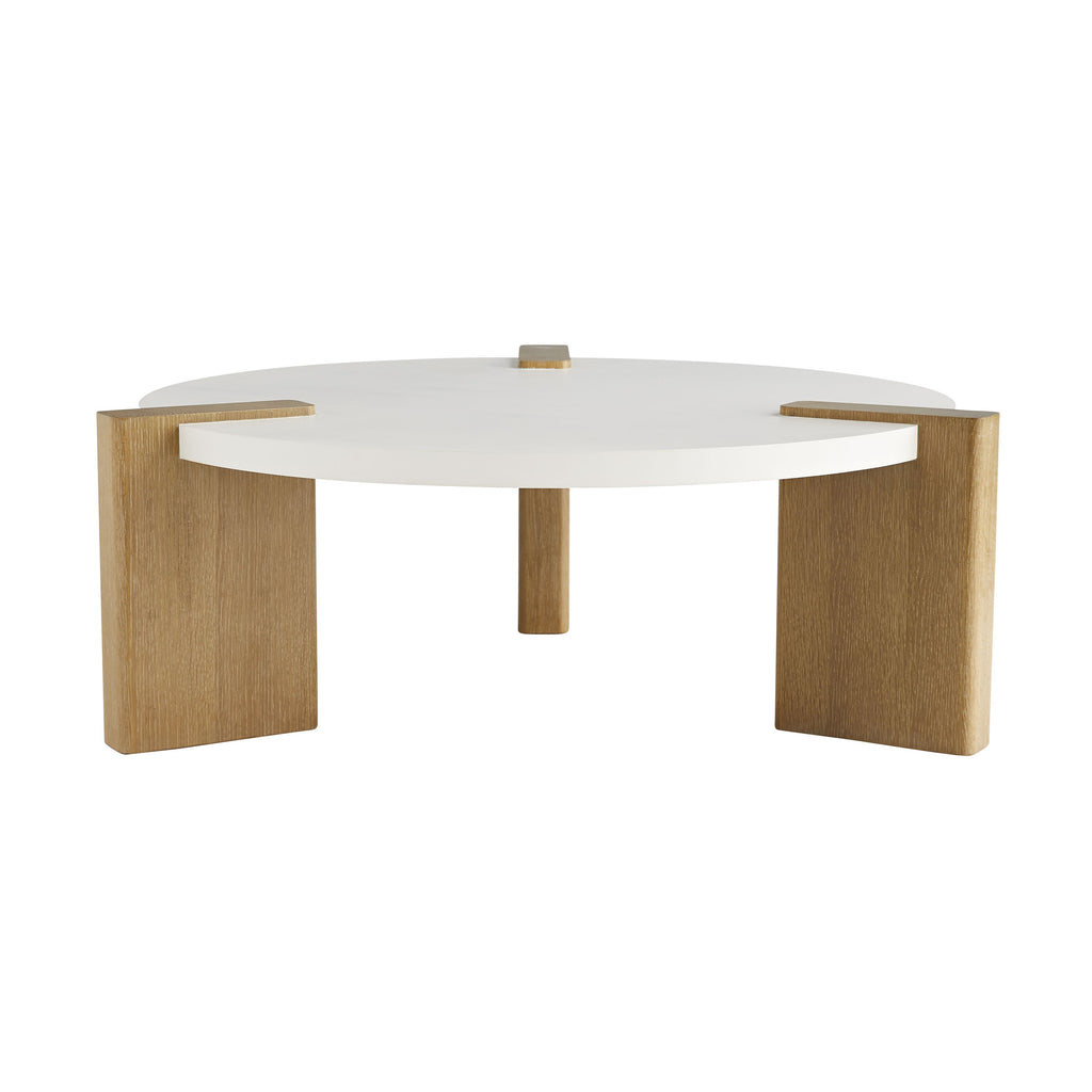 "Contemporary meets craftsmanship in this cultivated Forrest White Cocktail Table. A white lacquer top is perfectly poised on—and partially pierced with—oak veneer in an oyster finish, giving the illusion of solid timber supports. We love the juxtaposition of the natural wood and modern surface. A transitional table for various decor settings. Cocktails, anyone?  Size: 43"" d X 15.5"" h"