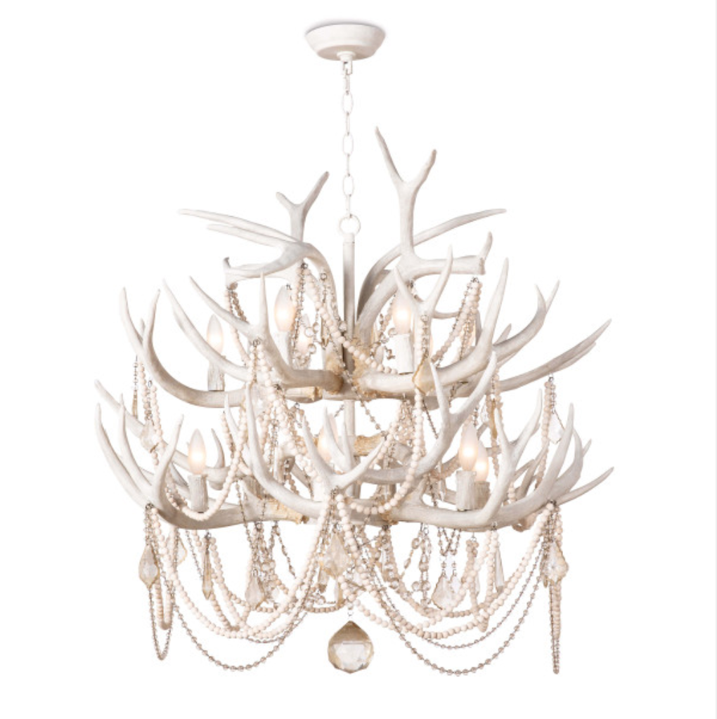 "Rustic meets luxe vibe with this Cheyanne Antler Chandelier by Regina Andrew. The antlers matched with the tea stained crystals make a statement in any living room, entryway or other area needing extra light.   Overall Dimensions: 33""w x 33""d x 40""h"