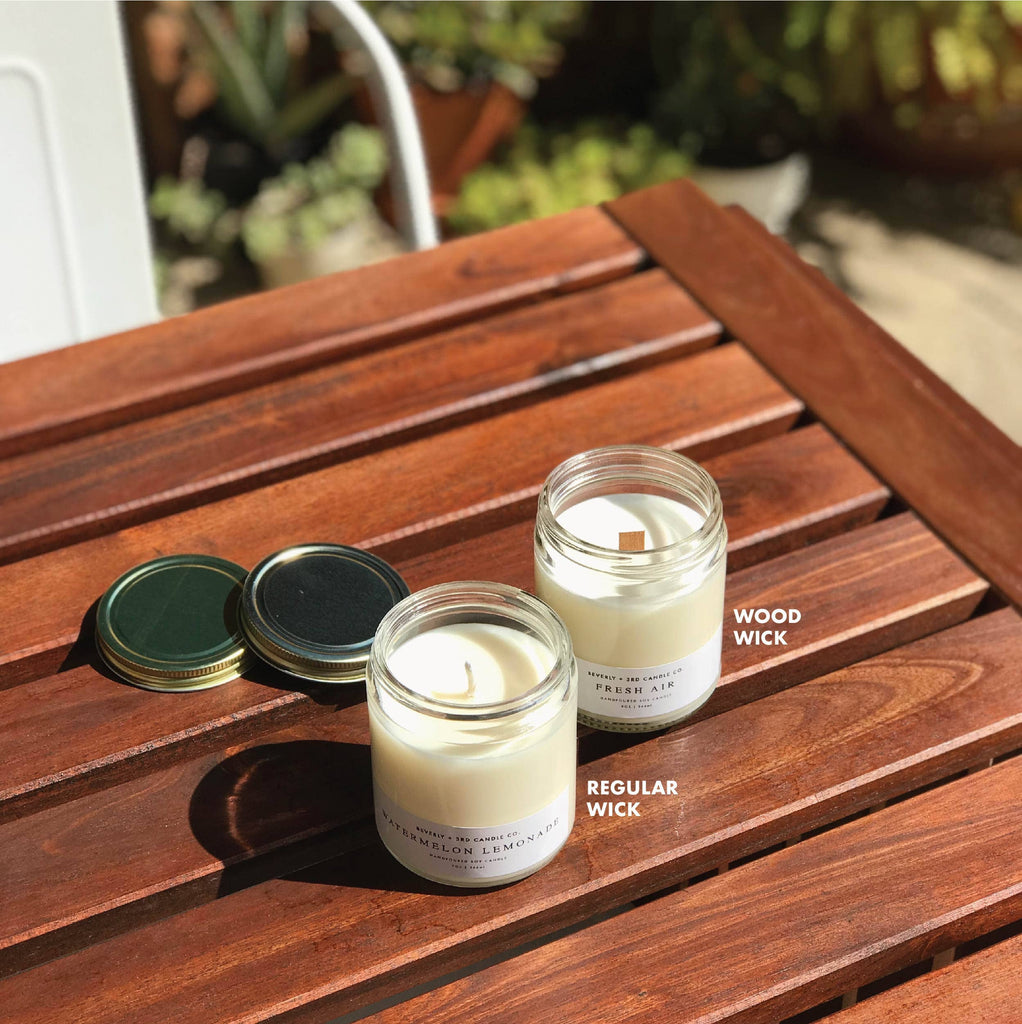 Close your eyes and imagine laying on the beach. The sun is warm, the waves are rolling onto the shore and a light aroma of sun tan lotion lingers in the air around you. Each candle is handcrafted in Illinois crafted from 100% American grown soy wax. We love the wood wick and the fine fragrance oils infused with essential oils. Each candle is Phtalate-free with a burn time of 70+ hours.  Size: 9oz