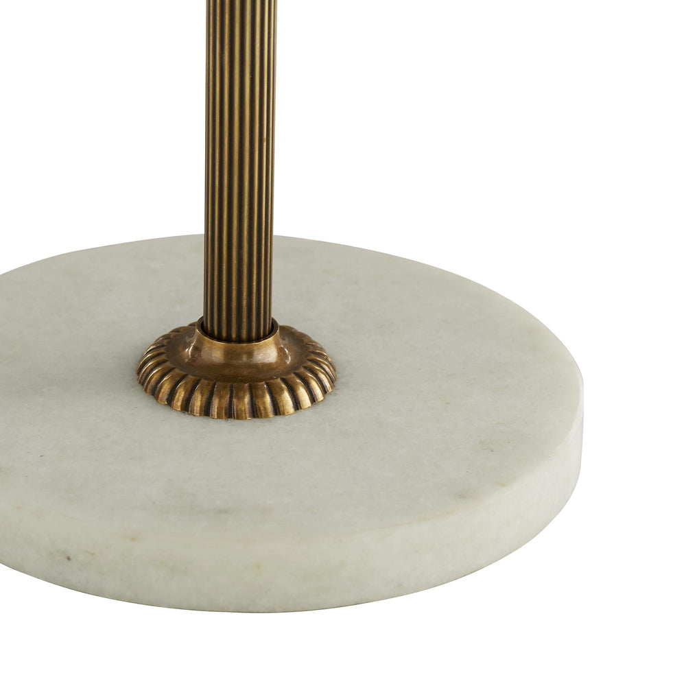 Poised in precision, the Marble & Brass Floor Lamp is the epitome of understated elegance. An ornate white marble base and rings on the antique brass body are unexpected. Topped with an off-white linen drum shade and matching antique brass finial. Marble may vary.
