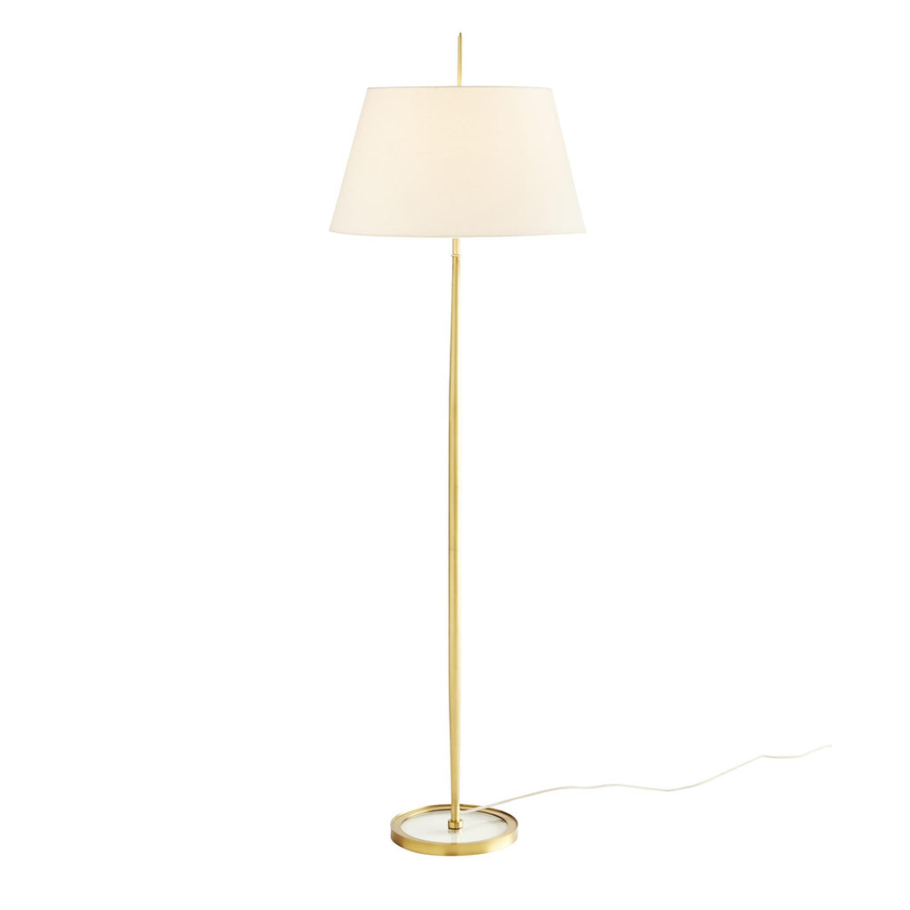 Sleek and simple, this ultra-minimalist floor lamp has wonderful details that make it quite unique. The stainless steel frame is given warmth with an antique brass finish, with a matching finial so the shade seems suspended within the design. The disk base leaves a small footprint and is fitted with a clear plate of glass. Topped with a tapered, ivory linen shade and matching antique brass finial.