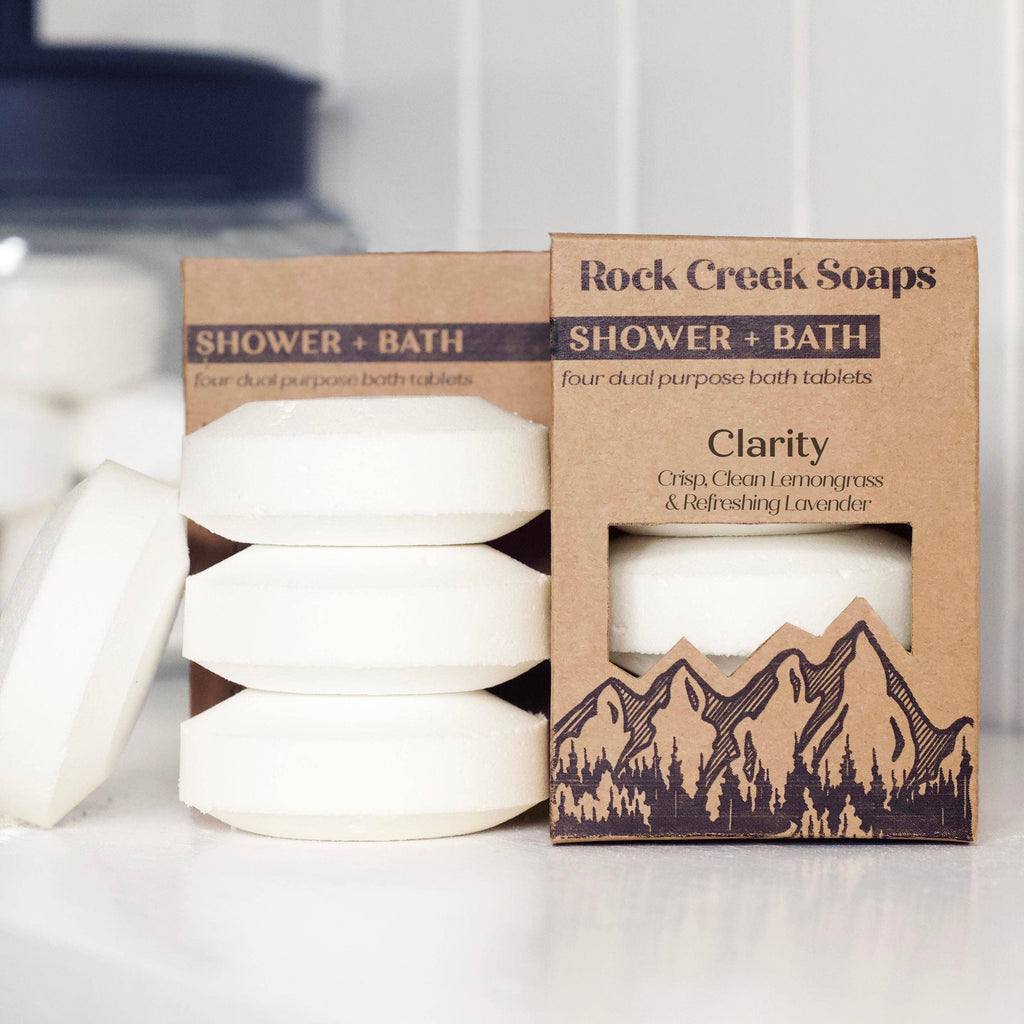 We love the versatility and satisfaction that the Clarity Shower + Bath Set by Rock Creek Soaps brings, scented in crisp, clean lemongrass and refreshing lavender. Set of 4. Each shower steamer tablet will last 2+ showers  For Aromatic Fizzing Bath: drop bath tablet into bath water to activate effervescent fizz.  For Aromatherapy Shower: to create the perfect aromatic shower place bath tablet away from the direct spray adding a splash of water to activate.