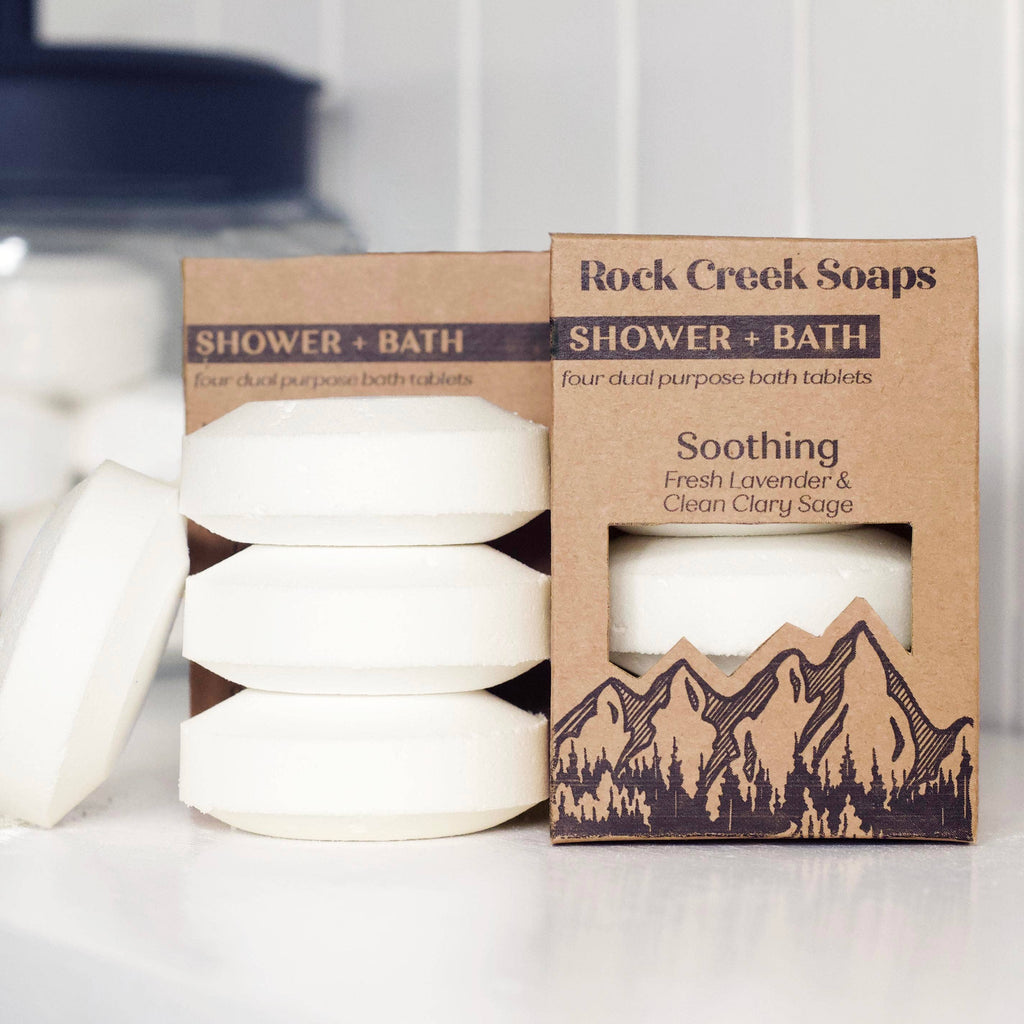 We love the versatility and satisfaction that the Soothing Shower + Bath Set by Rock Creek Soaps brings, scented in fresh lavender and clean clary sage. Set of 4. Each shower steamer tablet will last 2+ showers  For Aromatic Fizzing Bath: drop bath tablet into bath water to activate effervescent fizz.  For Aromatherapy Shower: to create the perfect aromatic shower place bath tablet away from the direct spray adding a splash of water to activate.