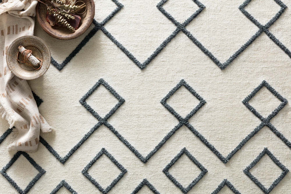 The Adler Collection pushes traditional flat-weaves to new heights. Its innovative high/low texture elevates the wool to form a pronounced pattern and faintly Moroccan style look. Hand-woven of 100% wool, Adler is available in a cool, on-trend set of neutral colors.  Hand-Woven 100% Wool AW-04 Ivory