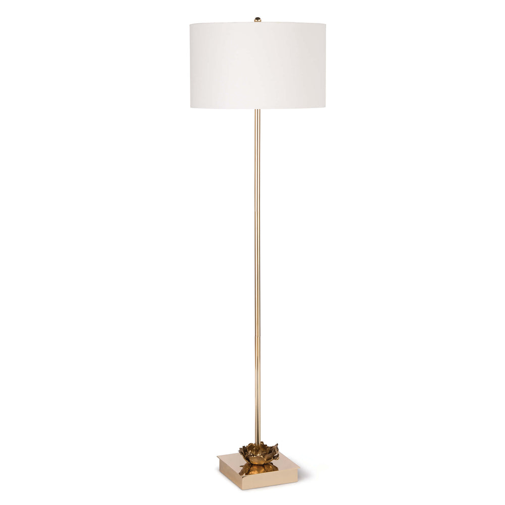 Boasting gold blossom-like accents throughout the base of the lamp and completed with a traditional shade, this piece is a forward-thinking work of art. Graduating metal flowers gilded in antique gold leaf sit atop a glamorous polished gold base.