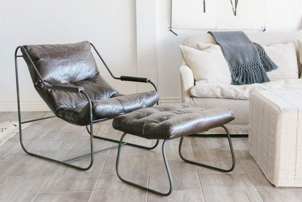 Amethyst Home features the Cisco Brothers Brando Leather Chair (BRA-CHR-026) with the Brando Leather Ottoman (BRA-OTT-025) in Spur Terracotta leather. The lifestyle photos feature the Brando Leather Chair and Ottoman in a discontinued Solvang Anthracite leather.