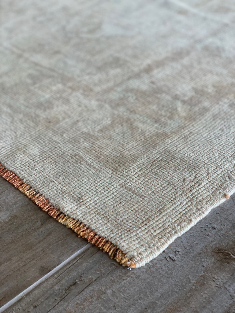 "The Angelica Vintage Rug is in beautiful condition and size. This hand knotted vintage Turkish Oushak rug is easy to care and maintain and will have very little shedding. This is a perfect runner in 3'0"" x 9'9"", 100% wool, and a great fit for a kitchen, hallway, or entryway."