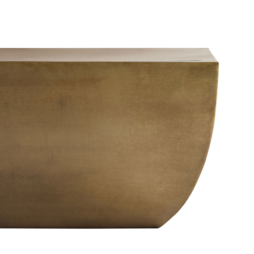 "This hallow Caroline Coffee Table has a unique shape with smooth curves and sharp angles. Finished in antique brass, it is slightly patinaed to bring a weathered, antique feel. A sophisticated piece to add to any living room or other space.   Overall size: 49.5""w x 30""d x 15""h  Material: Iron Finish: Antique Brass"