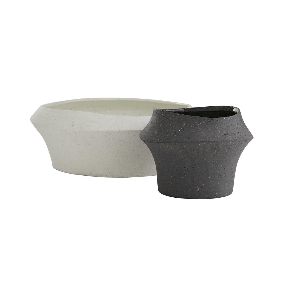 "This ceramic Pitman Vase Set of Two has a grainy, sand infused texture that brings an organic feel to any room. Your new favorite vase to sowcase on your shelf or entryway console!  Small Size: 9"" dia x 5.5"" h Large Size: 15"" dia x 6.5""h Material: Ceramic, Sand Infused Finish: Ivory, Charcoal"