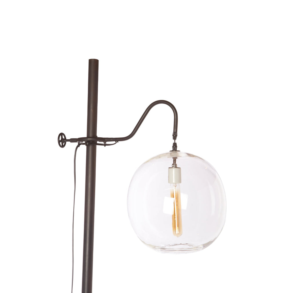 "The Aurora Lamp from Cisco Brothers adds a chic light to any room. Each lamp is hand blown glass and can vary up to 1"" in size. The light fixture can be height adjusted upon the metal rod to fit right where you need it. The lamp can come in a globe, bailey medium lamp, or bailey small lamp."